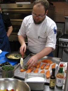 Chef Thompson tops salmon with sautéed spinach