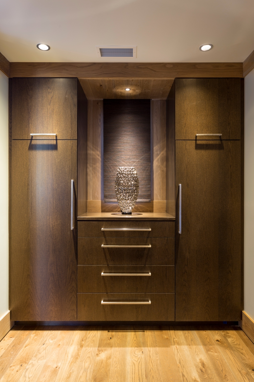 Custom Cabinets and Art are beautifully blended for this stunning suite
