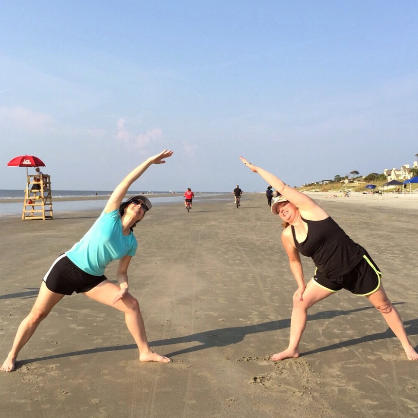 Michelle Rogers and I enjoying beach yoga.